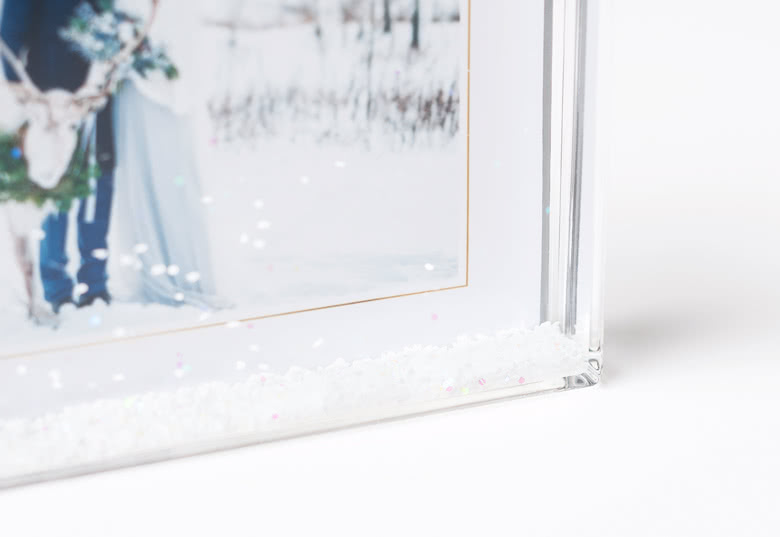 Photo frame with snow