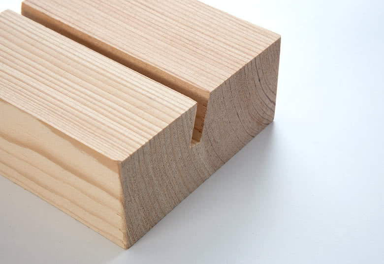 Polished wooden block with incision that fits 13 photo cards