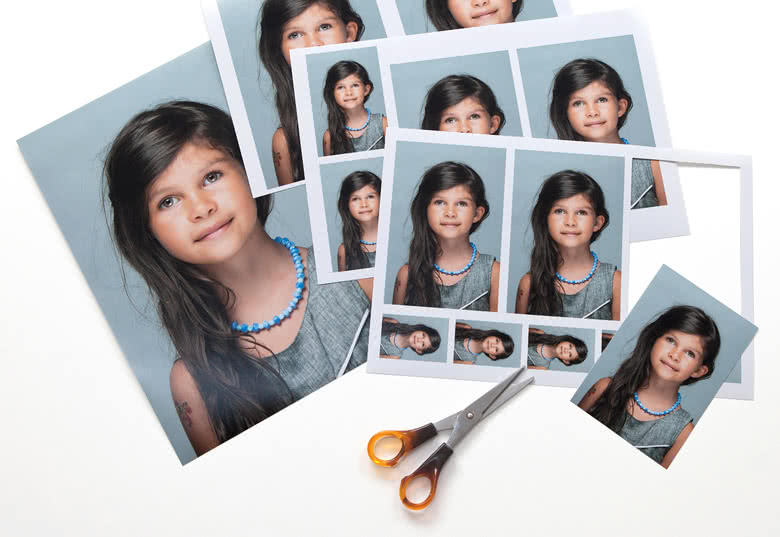 You receive 4 sheets with the same photo in different sizes that you can cut out yourself